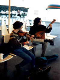 Susan Conger and Michael Kairys fiddling on the ferry